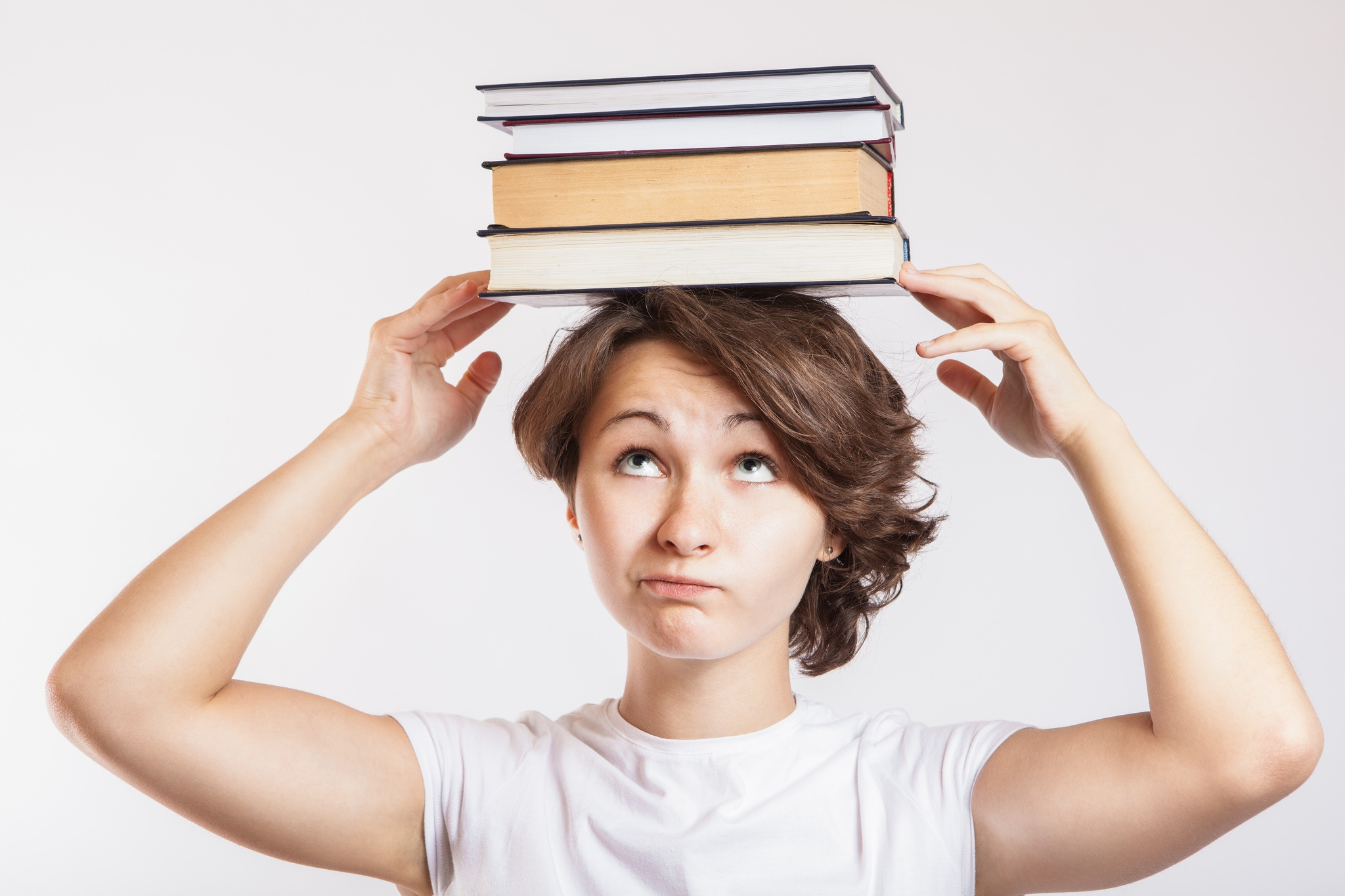 CollegeDegree360-Schoolgirl with books on head
