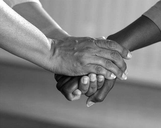 CC0 Public Domain-clasped hands – Copy